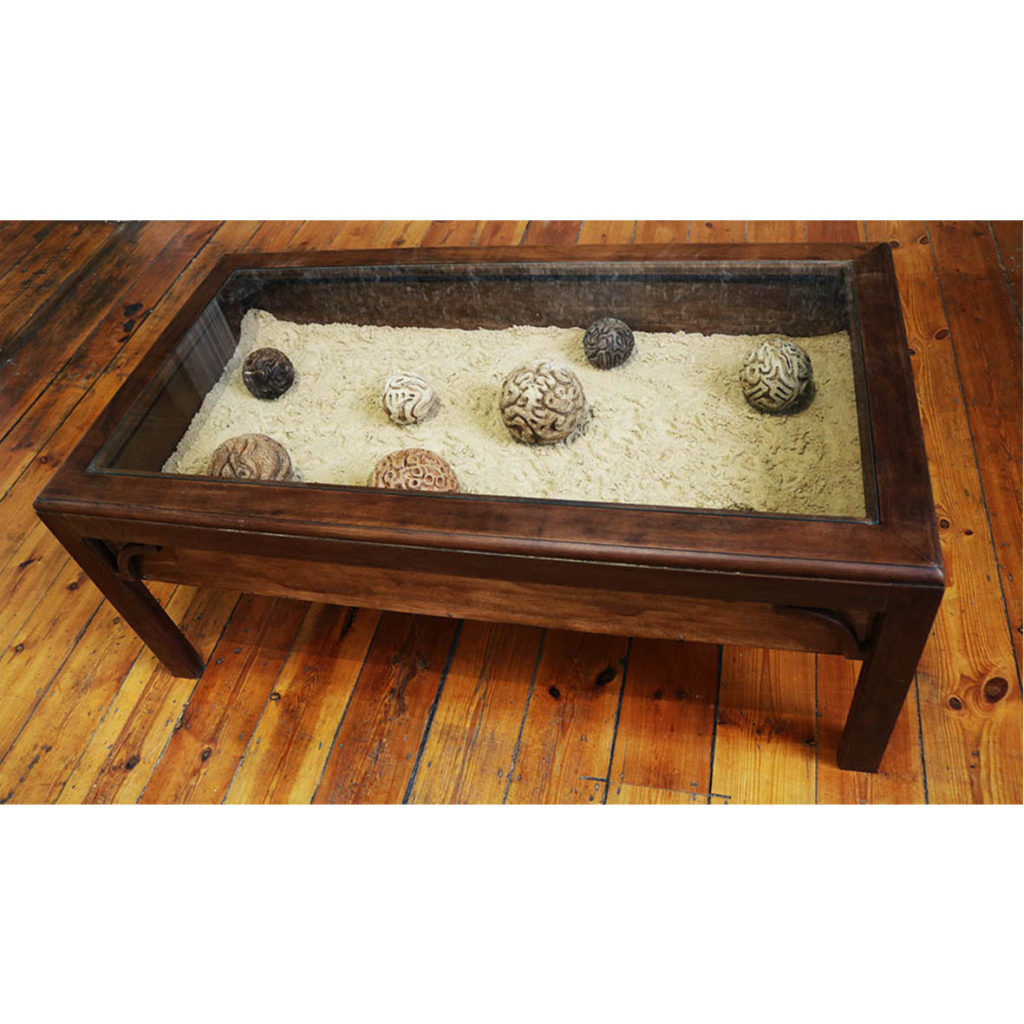 Aimee Lindeque Memory planets in sand table, wooden table with hand carved wooden balls 54 x 109 x 50 cm